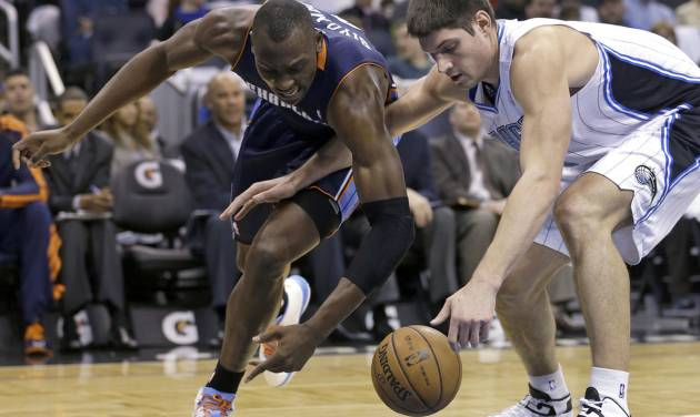 Charlotte Bobcats' Bismack Biyombo, left, and Orlando Magic's Nikola Vucevic go after a loose ball during the first half of an NBA basketball game, Friday, Jan. 18, 2013, in Orlando, Fla. (AP Photo/John Raoux)