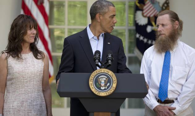President Barack Obama looks to Bob Bergdahl as Jani Bergdahl, stands at left, during a news conference in the Rose Garden of the White House in Washington on Saturday, May 31, 2014 about the release of their son, U.S. Army Sgt. Bowe Bergdahl. Bergdahl, 28, had been held prisoner by the Taliban since June 30, 2009. He was handed over to U.S. special forces by the Taliban in exchange for the release of five Afghan detainees held by the United States. (AP Photo/Carolyn Kaster)