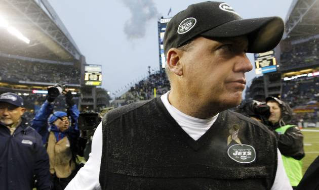 New York Jets head coach Rex Ryan walks off the field after his team lost to the Seattle Seahawks in an NFL football game, Sunday, Nov. 11, 2012, in Seattle. The Seahawks won 28-7. (AP Photo/Elaine Thompson)