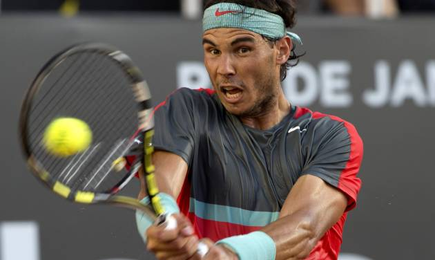 Rafael Nadal, of Spain, returns the ball to Alexandr Dolgopolov, of Ukraine, during their final game at the Rio Open tennis tournament in Rio de Janeiro, Brazil, Sunday, Feb. 23, 2014. (AP Photo/Silvia Izquierdo)