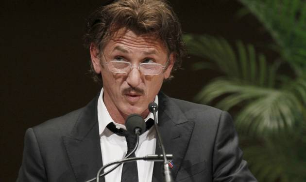 Actor Sean Penn addresses the crowd after receiving the 2012 Peace Summit Award from Mikhail Gorbachev, former President of the Union of Soviet Socialist Republics, during the World Summit of Nobel Peace Laureates Wednesday, April 25, 2012, in Chicago. (AP Photo/Charles Rex Arbogast)