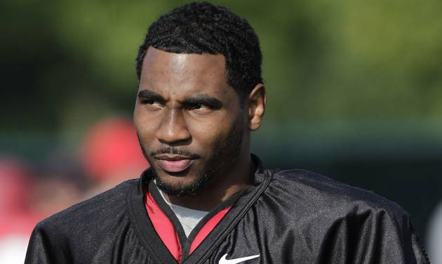 FILE - In this Aug. 9, 2014, file photo, Ohio State quarterback Braxton Miller watches teammates warm up during an NCAA college football practice in Columbus, Ohio. Miller, among the top contenders for the Heisman Trophy, reportedly reinjured his throwing shoulder during practice. The report about the two-time Big Ten offensive player of the year comes with just more than two weeks before the No. 5 Buckeyes open the season. (AP Photo/Jay LaPrete, File)