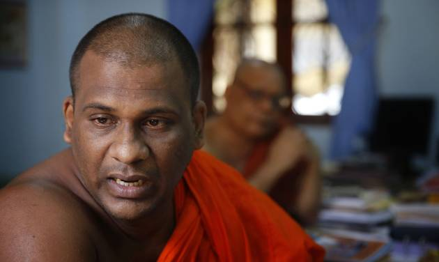 In this Sunday, Nov. 17, 2013 photo, Galagoda Atte Gnanasara, a 37-year-old Buddhist monk who founded the Bodu Bala Sena (BBS) group, or Buddhist Power Force in 2012, speaks during an interview at BBS office in Colombo, Sri Lanka. With a bloody civil war over and a cautious peace at hand, the group of hardline Buddhist monks is rallying Sri Lankans against what they say is a pernicious threat: Muslims. In just over a year, the saffron-swathed monks of BBS have amassed a huge following, drawing thousands of fist-pumping followers who rail against the country's Muslim minority. (AP Photo/Manish Swarup)