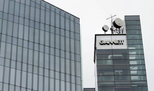 FILE - This file photograph taken July 14, 2010, shows Gannett headquarters in McLean, Va. Gannett Co. said Tuesday, Feb. 4, 2014, that its fourth-quarter net income dropped 12 percent, partially a result of the absence of the record-high political advertising that boosted its results a year earlier. (AP Photo/Jacquelyn Martin, file)