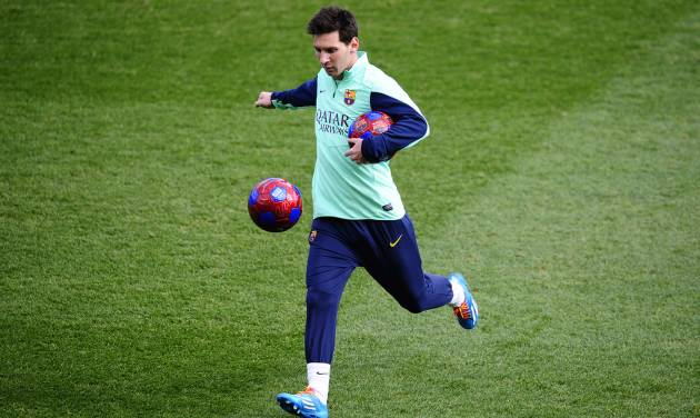 FC Barcelona's Lionel Messi, from Argentina, kicks the ball during a training session at the Mini Stadi Stadium in Barcelona, Spain, Friday, Jan. 3, 2014. (AP Photo/Manu Fernandez)