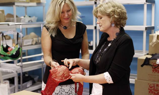 In this July 31 2014 photo, Marcia Cubitt, president, Essential Bodywear, left, and CEO Carrie Charlick talk about a bra in Commerce Township, Mich. Charlick and Cubitt have $4 million in sales but have been rejected for $500,000 credit lines since 2012. (AP Photo/Paul Sancya)