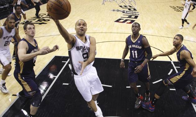 San Antonio Spurs' Tony Parker (9), of France, scores against the New Orleans Pelicans during the first half of an NBA basketball game, Monday, Nov. 25, 2013, in San Antonio. (AP Photo/Eric Gay)