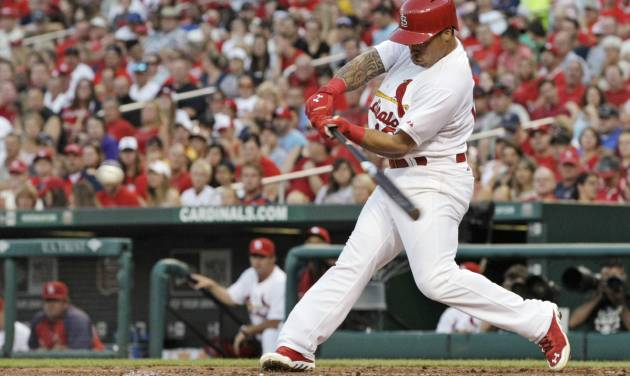 St. Louis Cardinals' Kolten Wong (16) connects for a two-RBI double in the second inning of a baseball game against the Pittsburgh Pirates, Tuesday, July 8, 2014, in St. Louis. (AP Photo/Tom Gannam)