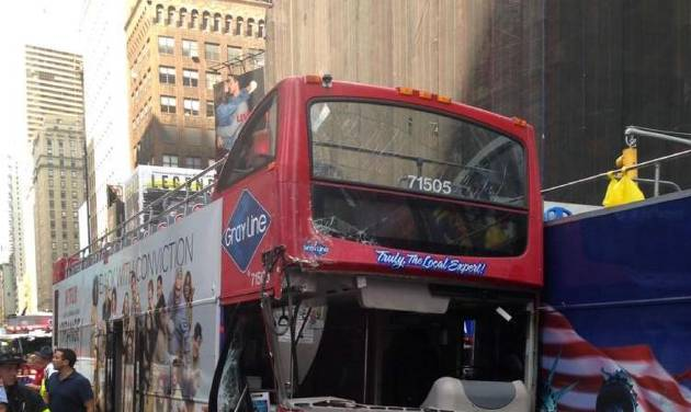 In this photo downloaded off the New York City Fire Department Twitter Site, emergency personnel respond to a collision between two double-decker busses on New York City's Times Square, Tuesday, Aug. 5, 2014. The Theater District accident injured 13 people, three of them seriously. (AP Photo/New York City Fire Department)