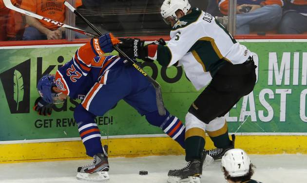 Taylor Hall of the Oklahoma City Barons and Jamie Oleksiak of the Texas Stars fight or the puck during an AHL hockey game at the Cox Convention in Oklahoma City, Friday, Dec. 21, 2012. Photo by Bryan Terry, The Oklahoman