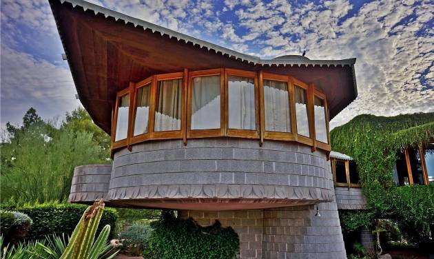 This undated image provided by the Frank Lloyd Wright Building Conservancy shows the home that Wright, the famous architect, built for his son in Phoenix, Ariz.. The city council is considering granting the house landmark designation to temporarily protect it from being torn down by the developer who currently owns it. In the meantime, along with other historic homes on self-guided tours, it's one of a number of free things to see and do in Phoenix. (AP Photo/Frank Lloyd Wright Building Conservancy, Scott Jarson, azarchitecture.com)