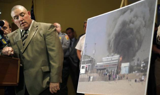 Ocean County prosecutors office arson investigator Thomas Haskell Jr., uses a laser-pointer on a photograph of a fire that started last Thursday near a frozen custard stand on the boardwalk in Seaside Park, during a news conference in Toms River, N.J., Tuesday, Sept. 17, 2013  Authorities said the massive boardwalk fire was accidental and linked it to electrical wiring and equipment that was compromised by Superstorm Sandy nearly a year ago.  Investigators say the fire, which destroyed more than 50 boardwalk businesses, started under a building that housed a candy store and an ice cream stand. (AP Photo/Mel Evans)