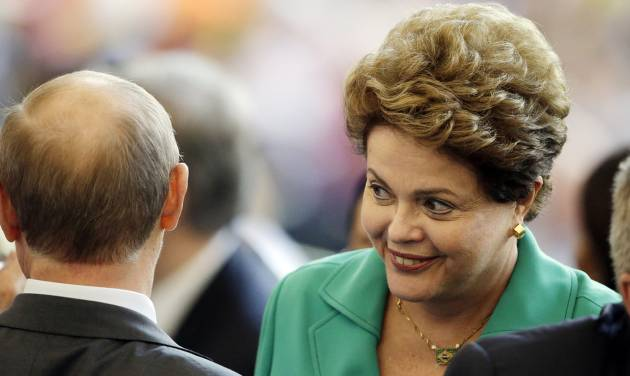 Brazil's President Dilma Rousseff speaks with Russian President Vladimir Putin during the World Cup final soccer match between Germany and Argentina at the Maracana Stadium in Rio de Janeiro, Brazil, Sunday, July 13, 2014. (AP Photo/Themba Hadebe)