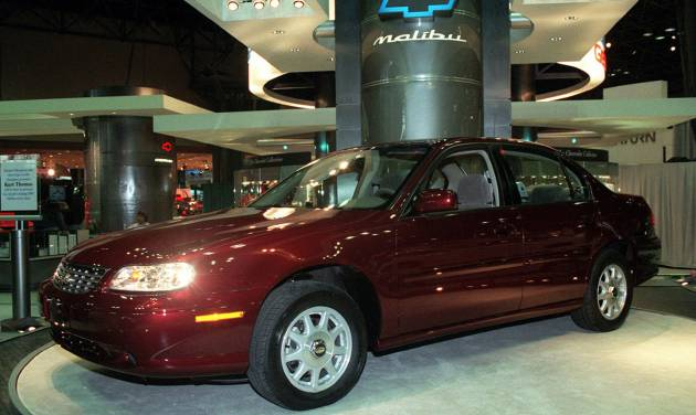 """File-This March 27, 1997, file photo shows 1998 Chevrolet Malibu at the media preview of the New York International Automobile Show.  General Motors' safety crisis worsened on Monday, June 30, 2014, when the automaker added 8.2 million vehicles to its huge list of cars recalled over faulty ignition switches. The latest recalls cover seven vehicles, including the Chevrolet Malibu from 1997 to 2005 and the Pontiac Grand Prix from 2004 to 2008. The recalls also cover a newer model, the 2003-2014 Cadillac CTS. GM said the recalls are for """"unintended ignition key rotation."""" (AP Photo/Ed Bailey, File)"""
