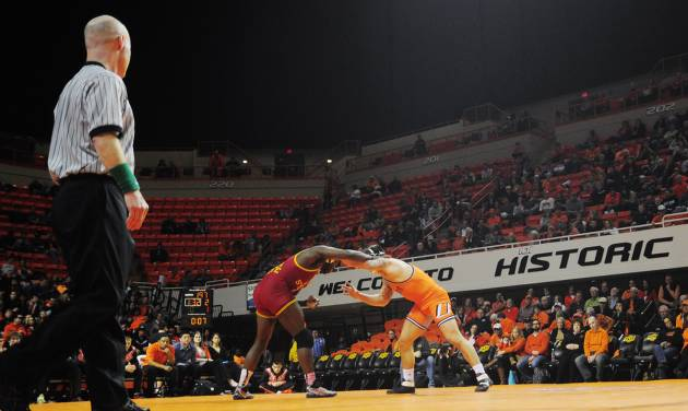 Oklahoma State 197-pound wrestler Kyle Crutchmer and Iowa State's Kyven Gadson grapple during a wrestling dual between Oklahoma State and Iowa State at Gallagher Iba Arena in Stillwater on January 24, 2014. Oklahoma State defeated Iowa State 29-3. Photo by KT King/For the Oklahoman