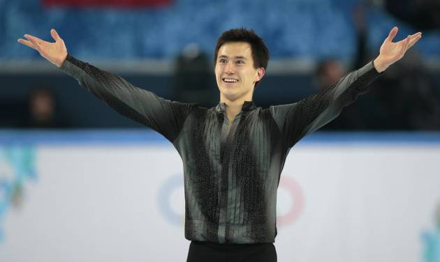 Patrick Chan of Canada acknowledges the crowd after completing his routine in the men's short program figure skating competition at the Iceberg Skating Palace during the 2014 Winter Olympics, Thursday, Feb. 13, 2014, in Sochi, Russia. (AP Photo/Ivan Sekretarev)