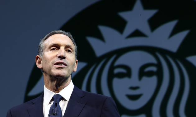 """FILE - In this March 20, 2013 file photo, Starbucks CEO Howard Schultz speaks at the company's annual shareholders meeting, in Seattle, Wash. Schultz is collaborating on a book about veterans of the wars in Iraq and Afghanistan. """"For Love of Country: What Our Veterans Can Teach Us About Citizenship, Heroism, and Sacrifice"""" will be published by Alfred A. Knopf on Nov. 4. The book will be co-written by Washington Post correspondent and editor Rajiv Chandrasekaran. According to Knopf, which announced the book Monday, a """"majority"""" of author proceeds will be donated to veteran services organizations. (AP Photo/Ted S. Warren, File)"""