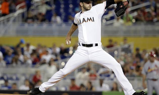 Miami Marlins starting pitcher Jarred Cosart throws in the first inning during a baseball game against the St. Louis Cardinals, Tuesday, Aug. 12, 2014, in Miami. (AP Photo/Lynne Sladky)