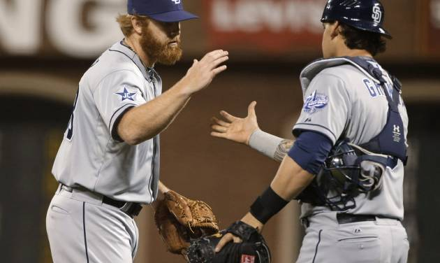 San Diego Padres relief pitcher Blaine Boyer, left, is greeted by catcher Yasmani Grandal at the end of a baseball game against the San Francisco Giants on Tuesday, June 24, 2014, in San Francisco. San Diego won 7-2. (AP Photo/Eric Risberg)