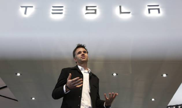 FILE - In this Tuesday, Jan. 15, 2013, file photo, Franz von Holzhausen, Chief Designer, Tesla Motors speaks at media previews for the North American International Auto Show in Detroit. Tesla reports quarterly earnings on Tuesday, Nov. 5, 2013. (AP Photo/Paul Sancya, File)