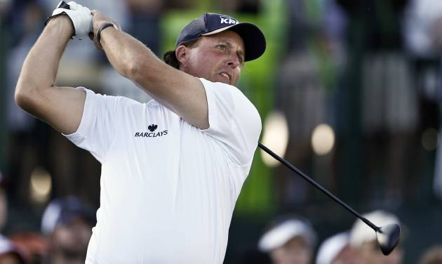 Phil Mickelson hits his tee shot on the 17th hole during the second round of the Waste Management Phoenix Open golf tournament on Friday, Feb. 1, 2013, in Scottsdale, Ariz. (AP Photo/Ross D. Franklin)