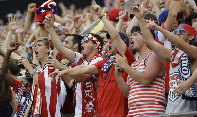 Fans cheer on the United States team during the second half of an international friendly soccer match between the United States and Nigeria in Jacksonville, Fla., Saturday, June 7, 2014. The United States won 2-1. (AP Photo/John Raoux)