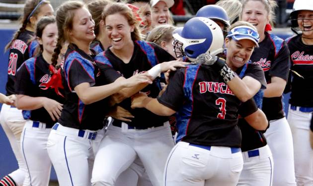 Chandler players pile on Darbi Duncan after she knocked in the winning run as Chandler defeats Valliant 11-10 in extra innings in the Class 5A State Championship Slow-Pitch Softball finals at ASA Hall of Fame Stadium on Tuesday, May 3, 2016 in Oklahoma City, Okla. Photo by Steve Sisney, The Oklahoman