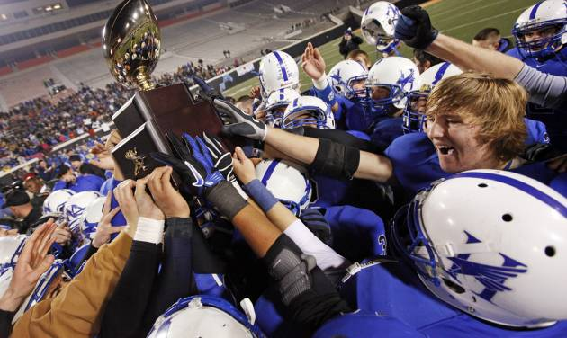 CELEBRATE / CELEBRATION: The Hennessey Eagles raise the gold ball trophy after the Class 2A high school football state championship game between Jones and Hennessey at Boone Pickens Stadium in Stillwater, Okla., Saturday, Dec. 10, 2011. Hennessey won, 21-7. Photo by Nate Billings, The Oklahoman
