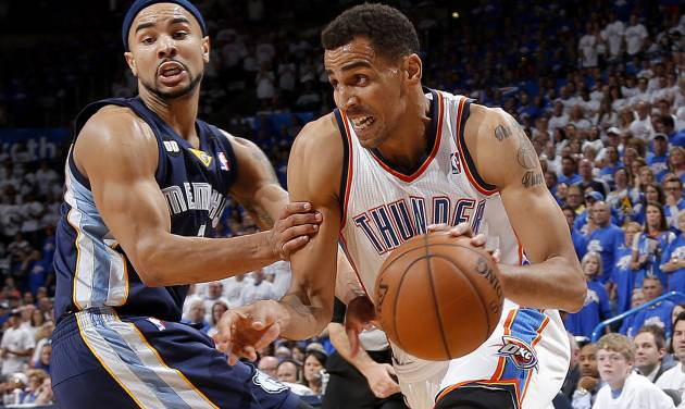 NBA BASKETBALL: Oklahoma City's Thabo Sefolosha (2) goes past Memphis' Jerryd Bayless (7)  during Game 2 in the second round of the NBA playoffs between the Oklahoma City Thunder and the Memphis Grizzlies at Chesapeake Energy Arena in Oklahoma City, Tuesday, May 7, 2013. Photo by Bryan Terry, The Oklahoman
