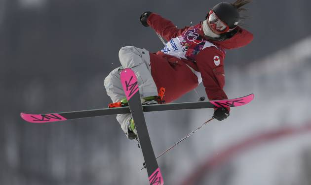 Canada's Yuki Tsubota takes a jump during the women's freestyle skiing slopestyle qualifying at the Rosa Khutor Extreme Park, at the 2014 Winter Olympics, Tuesday, Feb. 11, 2014, in Krasnaya Polyana, Russia.(AP Photo/Sergei Grits)