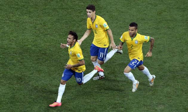 Brazil's Neymar, left, celebrates scoring his side's first goal during the group A World Cup soccer match between Brazil and Croatia, the opening game of the tournament, in the Itaquerao Stadium in Sao Paulo, Brazil, Thursday, June 12, 2014.  (AP Photo/Shuji Kajiyama)