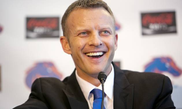 Boise State's new head coach Bryan Harsin smiles as he addresses a crowd of supporters and media during his introduction at an NCAA college football news Conference Friday, Dec. 13, 2013, in Boise, Idaho. (AP Photo/The Idaho Statesman, Kyle Green) MANDITORY CREDIT; LOCAL TV OUT
