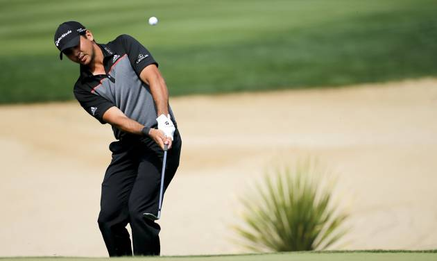 Jason Day hits a chip shot on the 17th hole in his match against Louis Oosthuizen, of South Africa, during the fourth round of the Match Play Championship golf tournament. Saturday, Feb. 22, 2014, in Marana, Ariz. (AP Photo/Matt York)