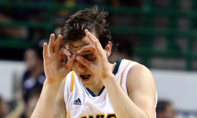 Baylor's Brady Heslip (5) reacts to a 3-point shot against Long Beach State during the first half of an NIT first-round college basketball game in Waco, Texas, Wednesday, March, 20, 2013. (AP Photo/Waco Tribune Herald, Rod Aydelotte)