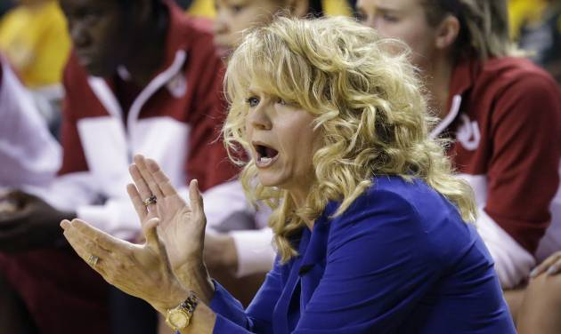Oklahoma head coach Sherri Coale cheers her team on from the sideline during the first half of an NCAA college basketball game against Baylor, Monday, Feb. 24, 2014, in Waco, Texas. (AP Photo/LM Otero)