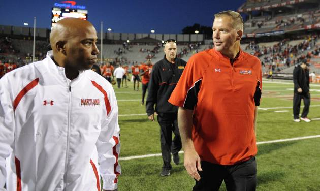 Maryland head coach Randy Edsall, right, walks off the field after defeating Wake Forest in an NCAA football game, Saturday, Oct. 6, 2012, in College Park, Md. (AP Photo/Nick Wass)