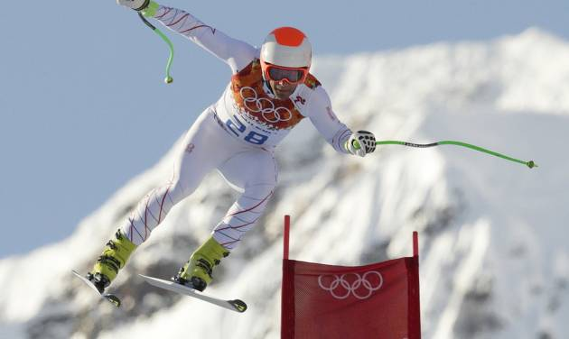 United States' Steven Nyman makes a jump during a men's downhill training run for the Sochi 2014 Winter Olympics, Friday, Feb. 7, 2014, in Krasnaya Polyana, Russia. (AP Photo/Charles Krupa)
