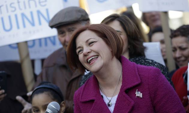Surrounded by family and supporters, New York City Council speaker and mayoral hopeful Christine Quinn, center, laughs while speaking to the media as she announces her mayoral run in New York, Sunday, March 10, 2013. The New York City Council speaker has formally launched what she hopes will be a history-making mayoral bid this fall. (AP Photo/Seth Wenig)
