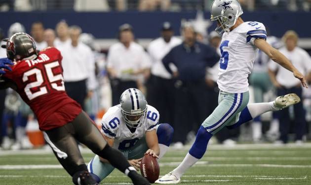 Dallas Cowboys kicker Dan Bailey (5) boots a field goal as Chris Jones (6) holds against the Tampa Bay Buccaneers during the first half of an NFL football game on, Sunday, Sept. 23, 2012, in Arlington, Texas. (AP Photo/LM Otero)