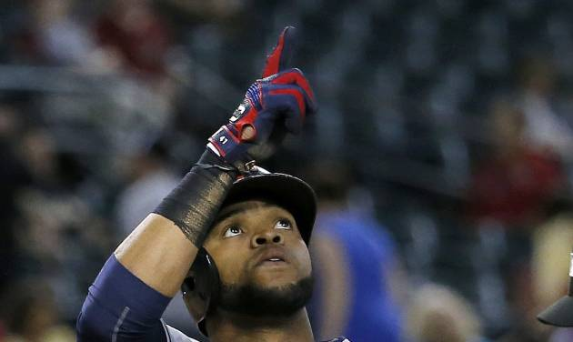 Cleveland Indians' Carlos Santana points upward after hitting a two-run home run against the Arizona Diamondbacks during the 11th inning of a baseball game, Tuesday, June 24, 2014, in Phoenix. (AP Photo/Matt York)