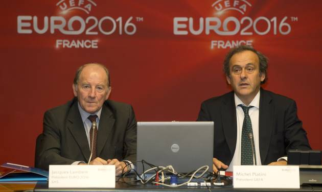 President of the EURO 2016 organizing committee Jacques Lambert, left, and UEFA President Michel Platini, right, attend a meeting to prepare the European Championship in France, at the headquarters of the French Football Federation in Paris, Tuesday, Oct. 23, 2012. (AP Photo/Michel Euler)