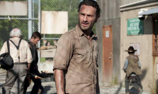 In this publicity photo provided by AMC, actor, Andrew Lincoln, as Rick Grimes, center, is shown in a scene from AMC&#039;s &quot;The Walking Dead,&quot; Season 3, Episode 1. (AP Photo/AMC, Gene Page) ORG XMIT: CAPH850