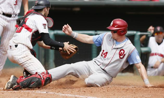 OU's Matt Oberste (14) slides home to score past Texas Tech catcher Mason Randolph (18) in the 8th inning during an NCAA baseball game between Oklahoma and Texas Tech in the Big 12 Baseball Championship tournament at the Chickasaw Bricktown Ballpark in Oklahoma City, Friday, May 24, 2013. OU won 8-0. Photo by Nate Billings, The Oklahoman