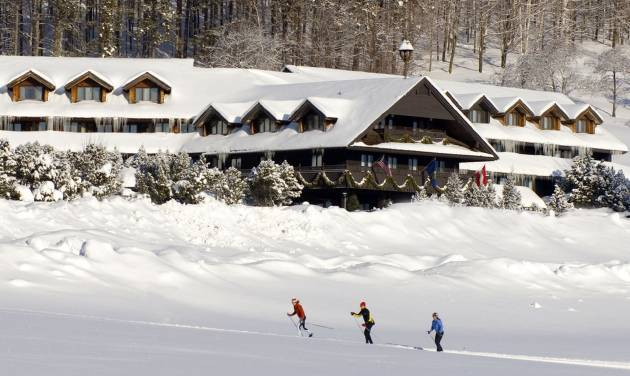 "This undated photo provided by the Trapp Family Lodge shows cross-country skiers outside the lodge  in Stowe, Vt. The lodge is owned by the famous singing family from ""The Sound of Music."" Family-owned resorts like the Trapp Family Lodge try to provide a personal touch for guests in an era when many resorts are owned by large corporations. (AP Photo/Trapp Family Lodge)"