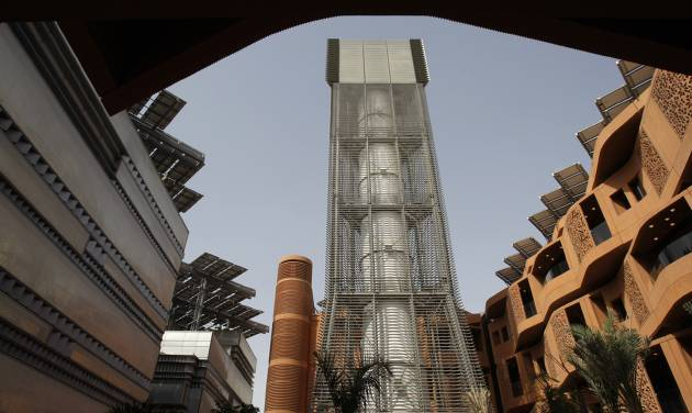FILE - In this Sunday, Jan. 16, 2011 file photo, the 45 meter height Wind Tower brings upper level wind to the public square at the Masdar Institute campus as a part of Masdar City in Abu Dhabi, United Arab Emirates. Hosting the climate talks is the latest bid by Qatar to flex its muscles on the international stage, following its successful bid to host the 2022 World Cup and its backing of Libyan and Syrian rebels. (AP Photo/Kamran Jebreili, File)