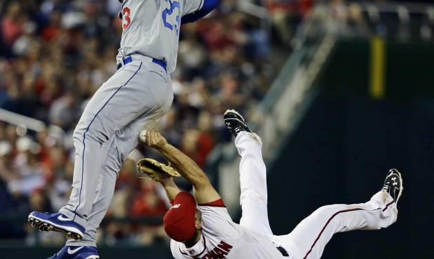 Washington Nationals third baseman Ryan Zimmerman makes the tag on Los Angeles Dodgers' Adrian Gonzalez (23) during the third inning of the second baseball game of a doubleheader at Nationals Park, Wednesday, Sept. 19, 2012, in Washington. The Dodgers won the second game 7-6. (AP Photo/Alex Brandon)