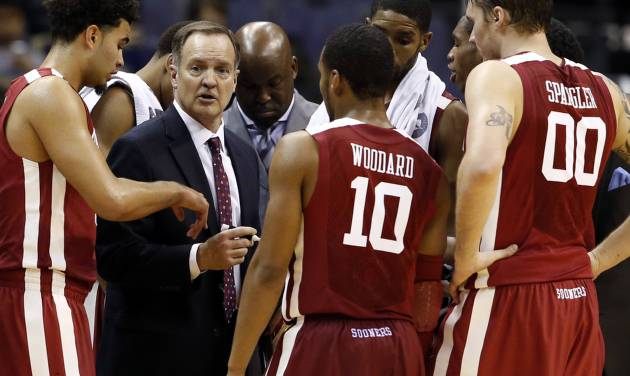 OU coach Lon Kruger talks to his team during a timeout in the second half of the Sooners' 81-66 win against George Mason at the BB&T Classic on Sunday. AP Photo