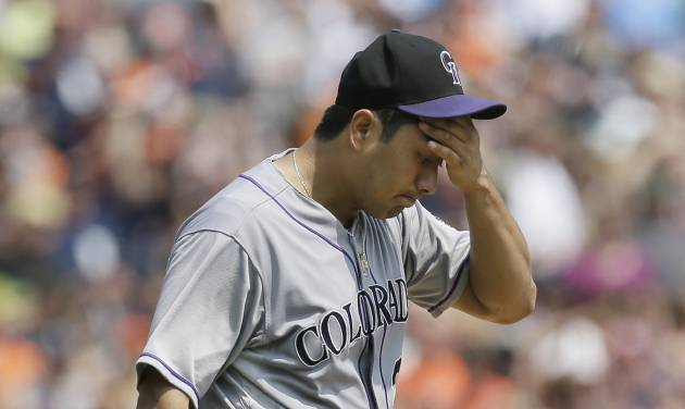 Colorado Rockies starting pitcher Jorge De La Rosa reacts after giving up a three-run home run to Detroit Tigers designated hitter Victor Martinez during the third inning of an interleague baseball game, Sunday, Aug. 3, 2014, in Detroit. (AP Photo/Carlos Osorio)