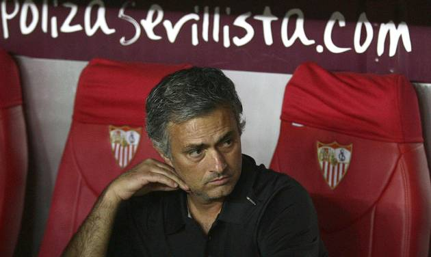 In this photo taken Saturday Sept. 15, 2012. Real Madrid's coach Mourinho from Portugal looks on during their La Liga soccer match against Sevilla at the Ramon Sanchez Pizjuan stadium, in Seville, Spain. (AP Photo/Angel Fernandez)