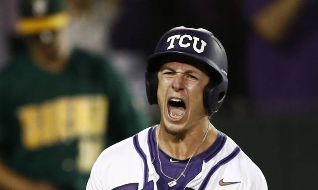 TCU's Cody Jones celebrates after scoring on the game-winning hit by teammate Boomer White against Siena during an NCAA college baseball regional tournament game in Fort Worth, Texas, Friday, May 30, 2014. TCU won in eleven innings 2-1. (AP Photo/Jim Cowsert)